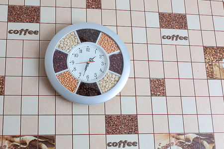 Modern electronic fashionable timepiece hanging on the wall in the kitchen beautiful. photo