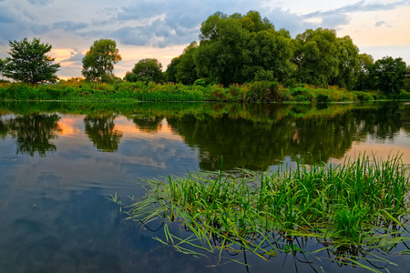 A warm, quiet summer evening on the banks of the Voronezh River in Central Russia. Фото со стока
