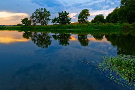 A warm, quiet summer evening on the banks of the Voronezh River in Central Russia. Imagens