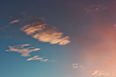 Beautiful blue sky with clouds of various shapes and colors. 写真素材