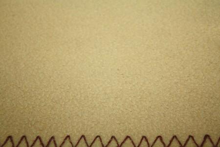 stitches: Soft beige textile pattern with decorative stitches below