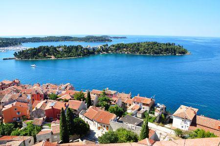 croatian: Rovinj town - coastline seascape panorama summer horizontal photo from bell tower Church of St.Euphemia, Croatia Stock Photo