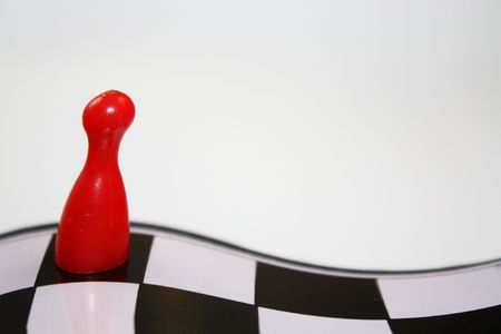 Deformed abstract bright red ludo piece on curvy chessboard with empty white background