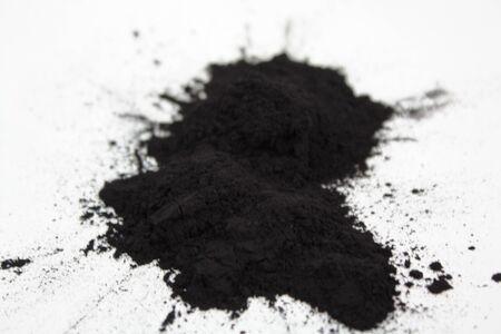 Splash charcoal black powder on white background 写真素材