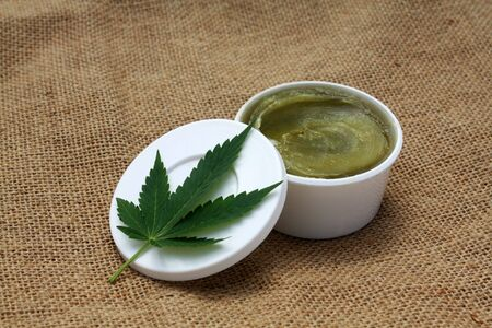 Green homemade ganja marijuana hemp ointment balm  medical herbal lotion