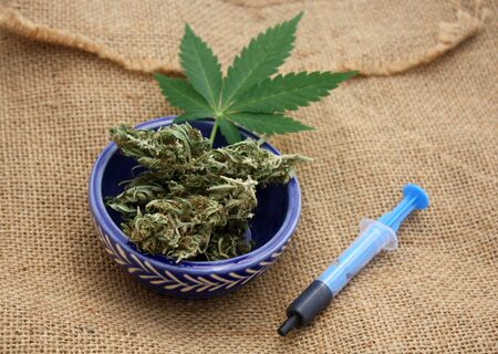 Phoenix tears or hash oil in syringe, medical marijuana concept.