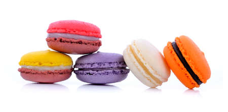 Sweet and colourful french macaron on white background