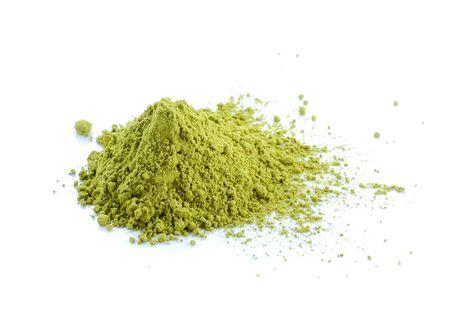 Powdered matcha green tea isolated on white background