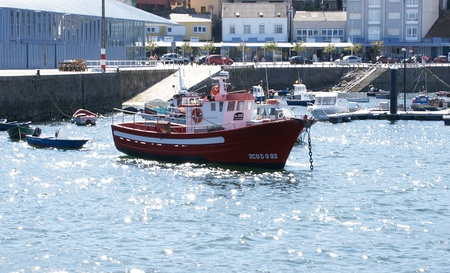 hitching post: Fishing boat in the port of Finisterre, Galicia, Spain