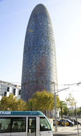 singular architecture: Tower Agbar and streetcar in Barcelona