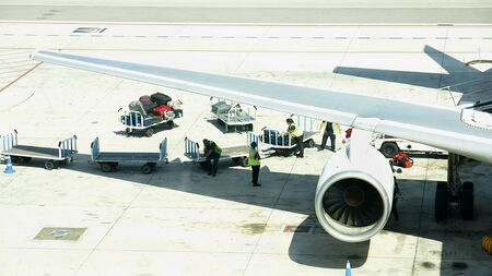runways: Load and unload of a plane in the airport