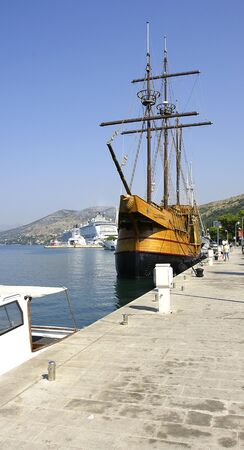 Ancient sailboat held up in the port of Dubrovnik, Croatia photo