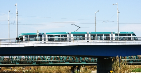 Streetcar on a bridge of the river Bes�s, Barcelona