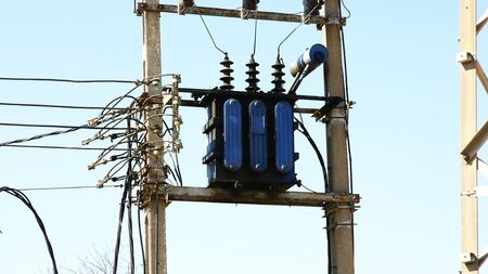 splice: Post with electrical transformer Stock Photo