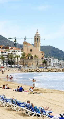 Panoramic of Sitges s beach with church to the fund photo