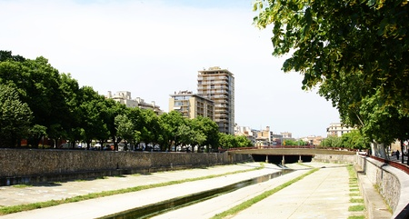 The river O�ar canalized to his step along Girona, Spain
