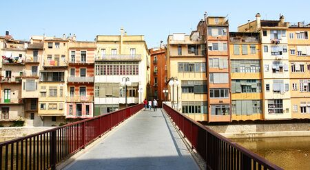 Bridge with fronts of fund on the river Onyar in Girona, Spain Stock Photo