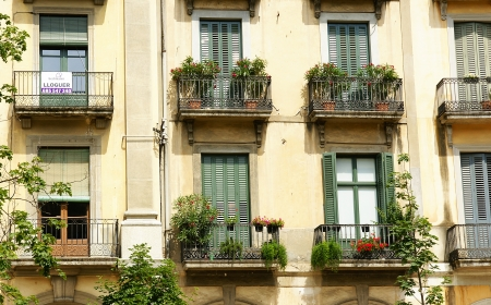 Front of windows and balconies in Girona, Spain photo