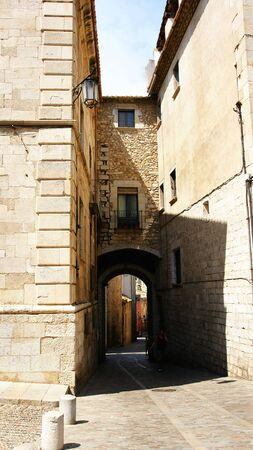 Alley of the ancient and historical city of Girona, Spain photo