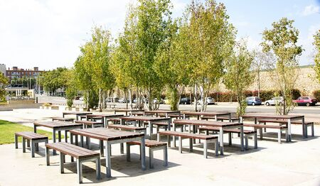 littoral: Benchs and tables in a park of the littoral of Barcelona