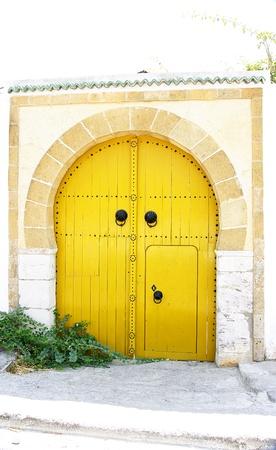 ccedil: Door yellow in a house in Sidi Bou Said, Tunisia