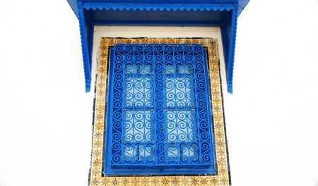 Blue window of a house in Sidi Bou Said, Tunis photo