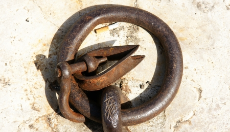 nailed: shackle nailed to the ground