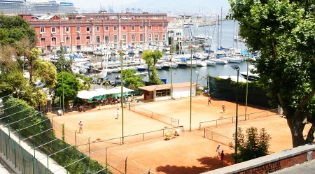 foci: Panoramic of tennis courts and port of Naples, Italy