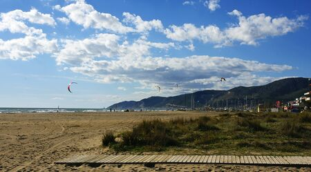 kitesurf: Panoramic of the beach of Castelldefes, Barcelona, with comets of kitesurf