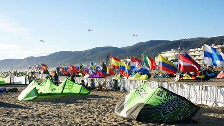 kitesurf: Comets of kitesurf on the sand of the Castelldefels s beach, Barcelona
