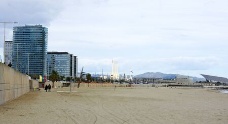 sky line: Panoramic of the beach of the Mar Bella with sky line of Barcelona Editorial