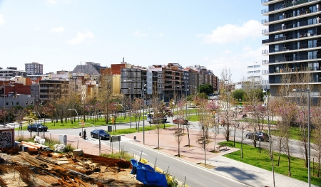 Panoramic of a road and gardens in Collblanc, Barcelona Stock Photo