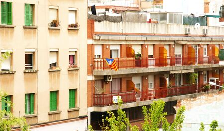separatism: Balcony with Catalan flag in the streets of Barcelona