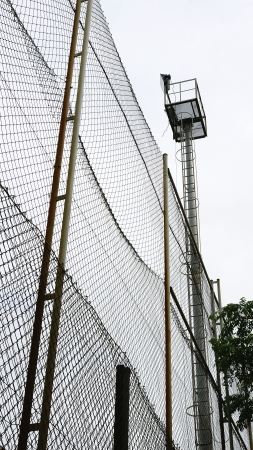 fenced in: Fence Protection of the Football Field of the Turo de la Peira, Barcelona Stock Photo
