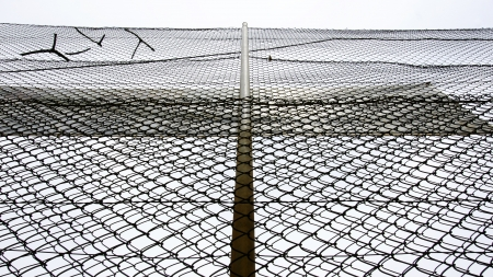 foci: Fence Protection of the Football Field of the Turo de la Peira, Barcelona Stock Photo