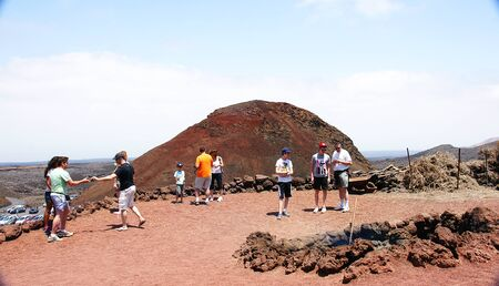 Tourists in Timanfaya Park in Lanzarote, Canary Islands Stock Photo - 21841374