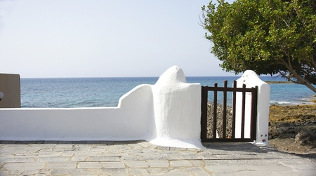 Wall with fence and sea in the background, Lanzarote, Canary Islands Stock Photo - 21882640