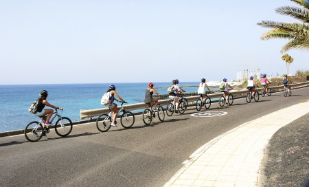 Cyclists on the road in Lanzarote, Canary Islands Stock Photo