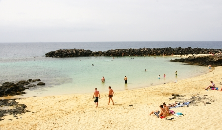 sun bathers: Beach in Costa Teguise, Lanzarote, Canary Islands
