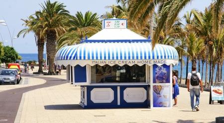 Promenade with cream kiosk and beach in Puerto del Carmen, Lanzarote, Canary Islands