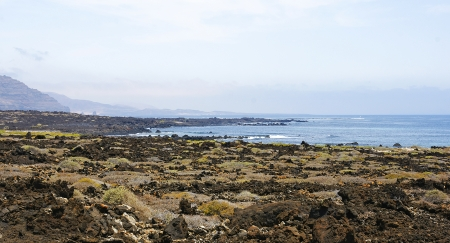 volcanic landscape: Volcanic landscape with sea at bottom in Lanzarote, Canary Islands