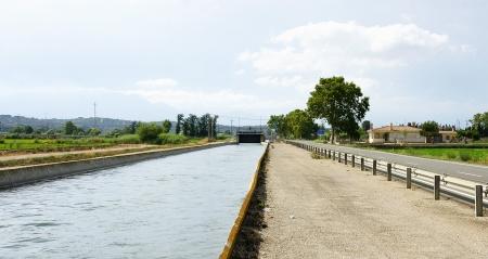 ebro: Canale di irrigazione nel Delta dell'Ebro, Tarragona Archivio Fotografico