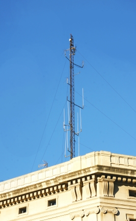 issuer: Telecommunications antenna on a rooftop in Barcelona