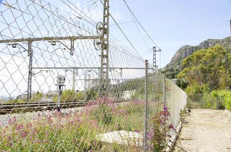 garraf: Track and catenary after the fence, El Garraf, Barcelona