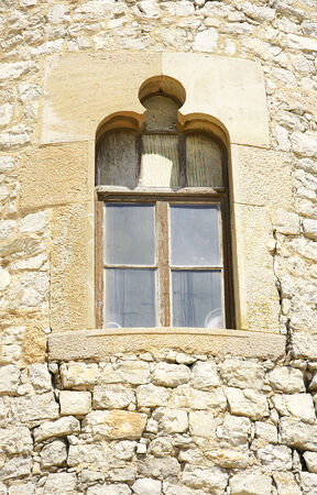 garraf: Window in the tower of the complex of wineries in El Garraf Guell, Barcelona  Stock Photo