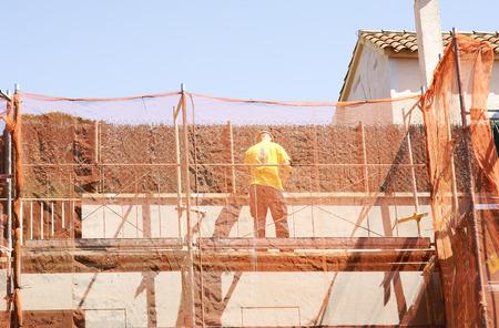 Rehabilitation of a facade of a building Редакционное