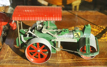 imitations: Replica of a toy road roller in a showcase