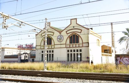 antique factory: actory anise next to the train tracks in Badalona, Barcelona