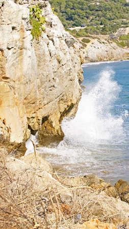 garraf: Waves crashing against rock in the Garraf Barcelona Stock Photo