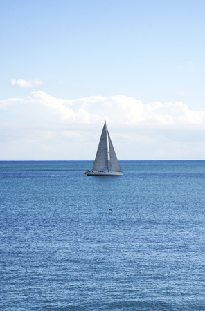 backlights: Sailboat in the Barcelona sea Stock Photo